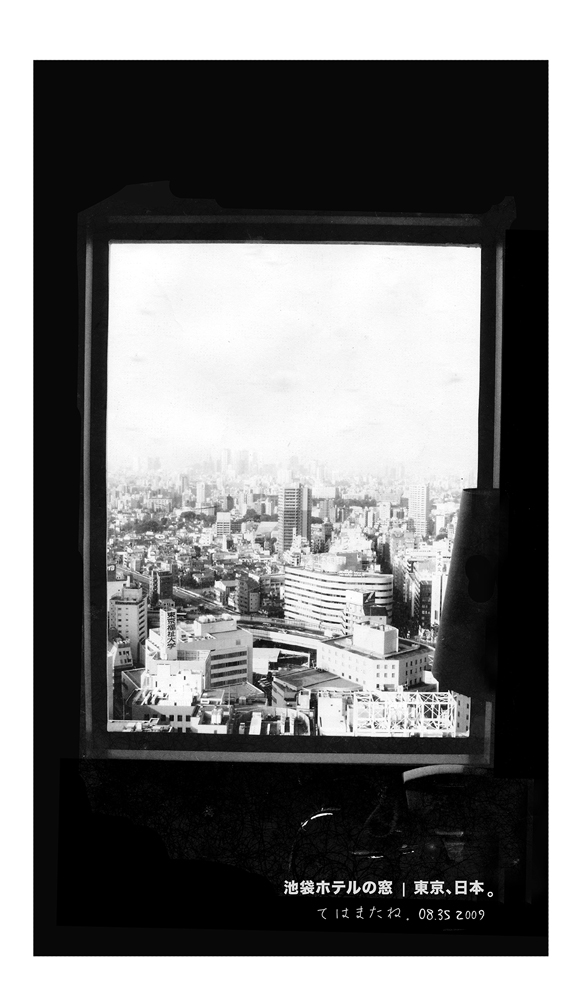 The Tokyo's urban skyline through the glass window at Ikebukuro hotel